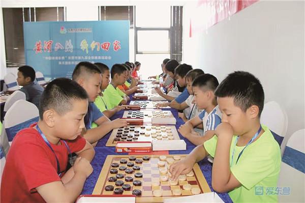 不拼体力拼智力!东营56名国际跳棋爱好者赛棋艺